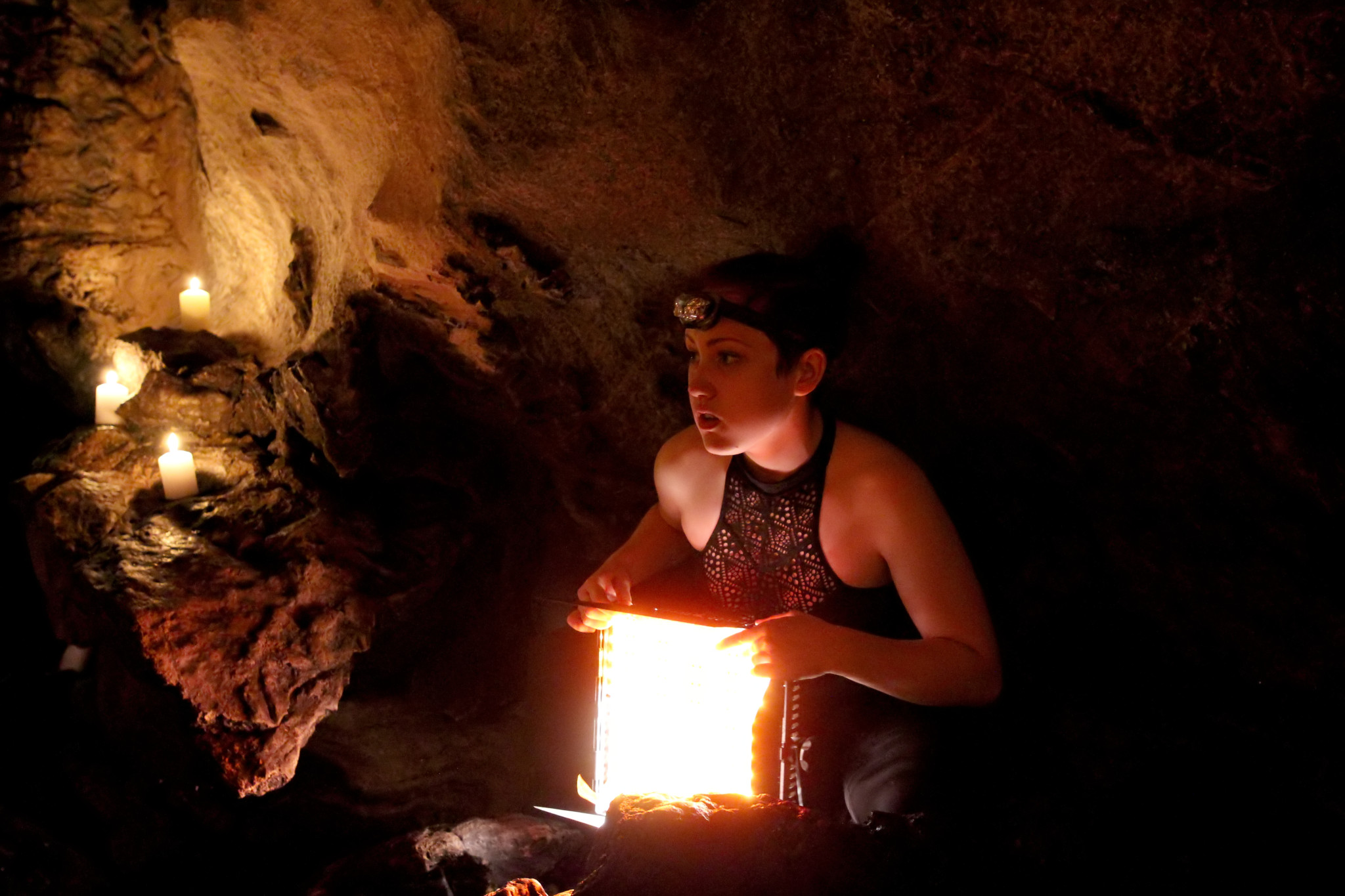 Morgana setting up lighting in Lusk Caves, Gatineau Park. Photo credit: Patrick Murray.