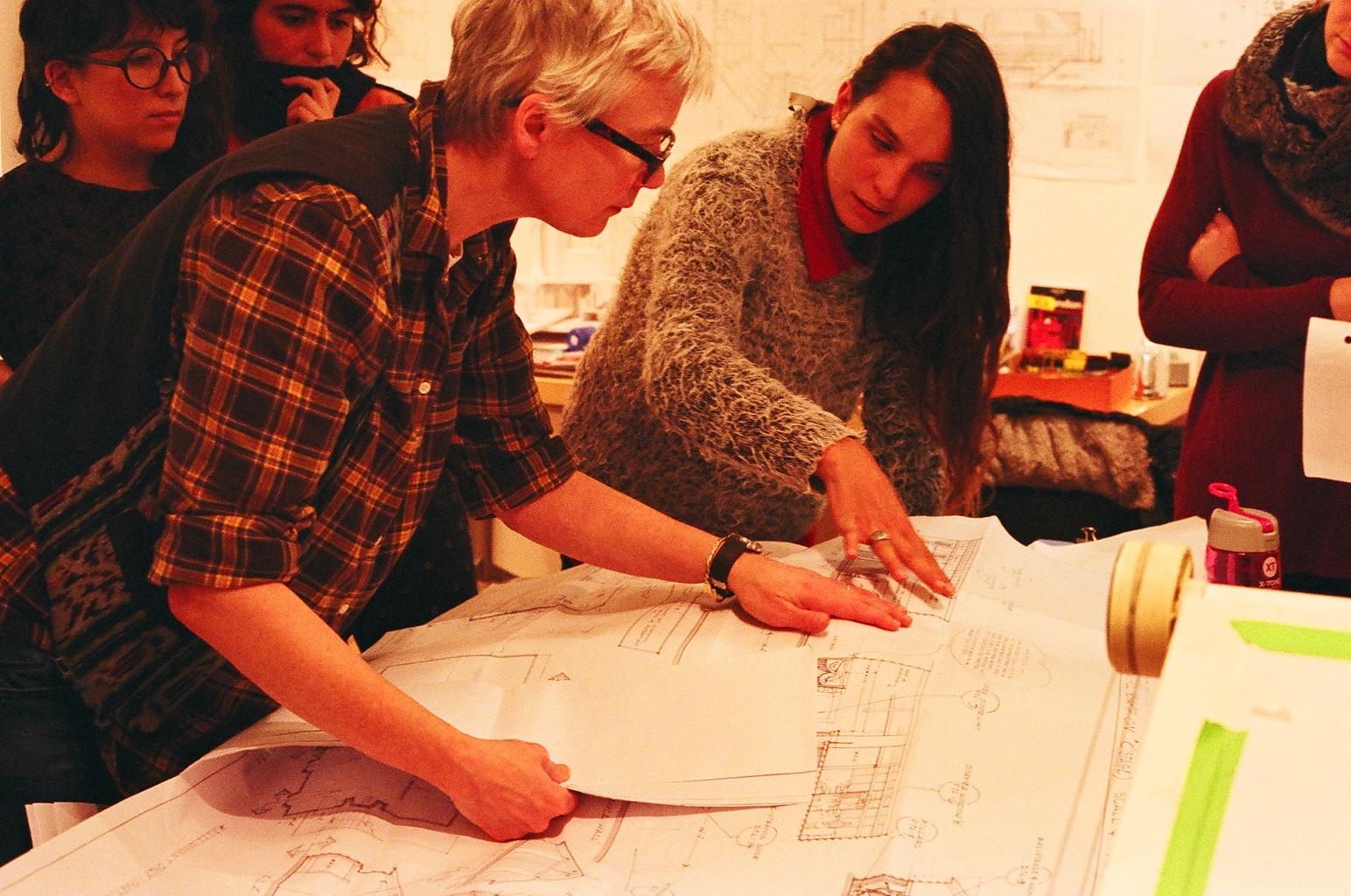 María Belén Cirio (Uruguay) discussing elevations with Fleur.